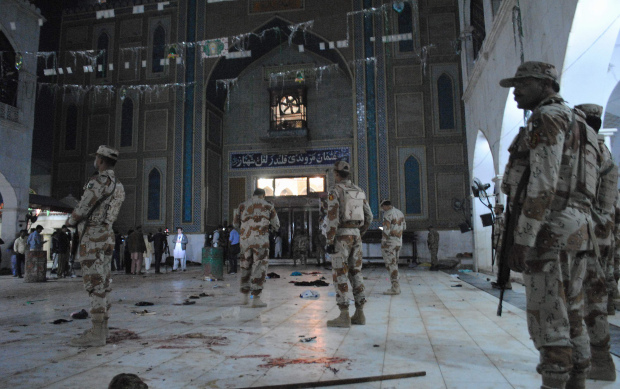 Pakistan detains dozens after 75 killed at Sufi shrine