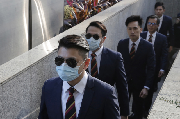 Seven Hong Kong policemen jailed for assault on democracy activist