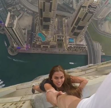 Dubai's Cayan Tower to sue Russian model, assistants for their daredevil stunt