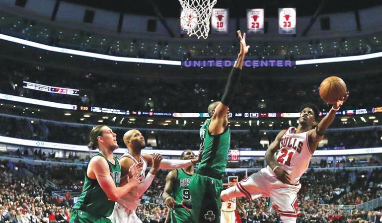 Butler shines as Bulls pip Celtics