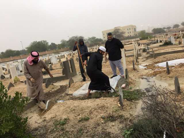 Rains uncover buried bodies in graveyards