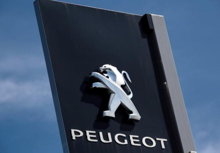 Peugeot promises May to 'develop' Vauxhall after takeover