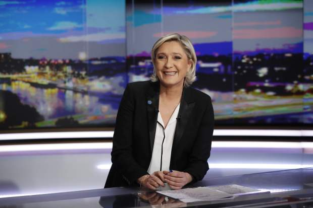 Le Pen retains French poll lead, still seen losing runoff
