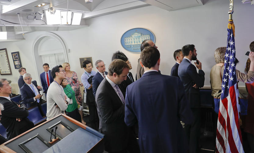 White House bars major news outlets from press briefing