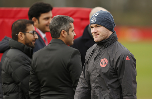 Rooney ends 'move to China' speculations