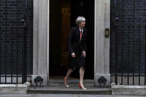 UK May's Conservatives gain parliamentary seat as rivals suffer election setbacks