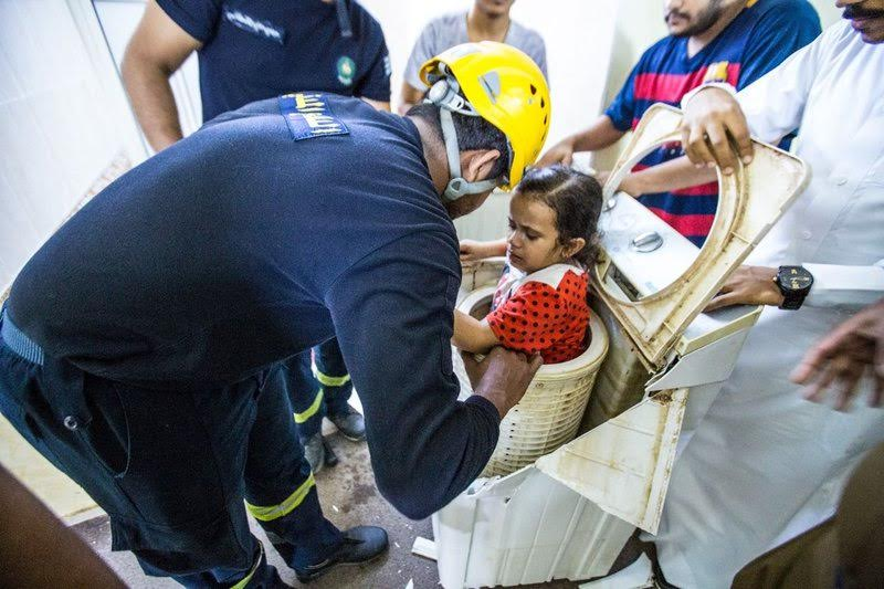 Girl rescued after getting stuck in a washing machine