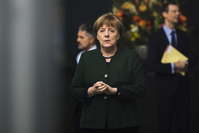 Merkel says, on NATO spending target, commitments have to be met