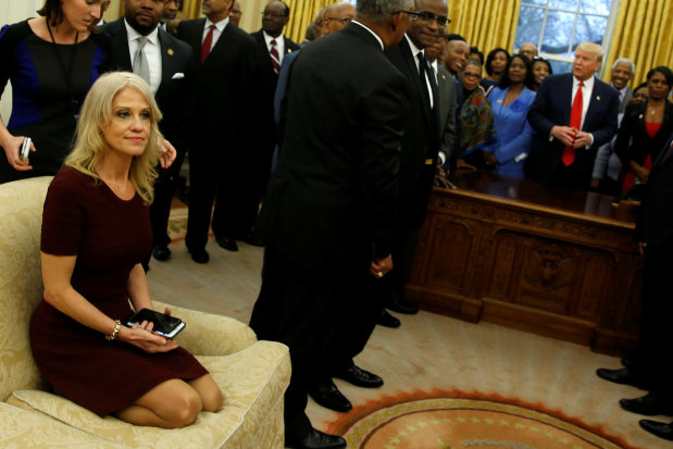 Trump aide Conway draws ire for kneeling on White House sofa