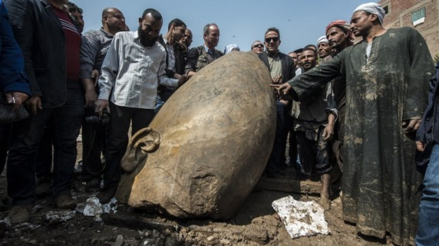 Pharaoh statues found in muddy Cairo pit