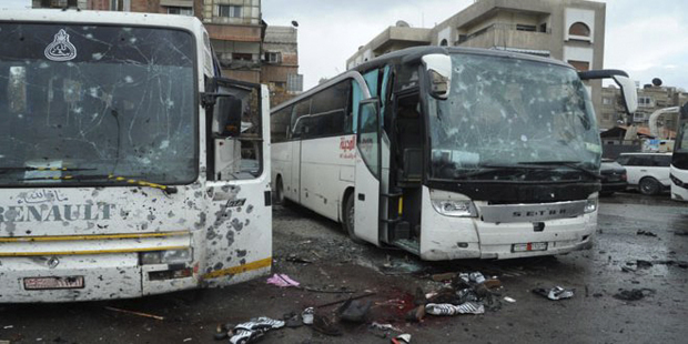 Twin blasts kill 40 near religious sites in Syria's capital