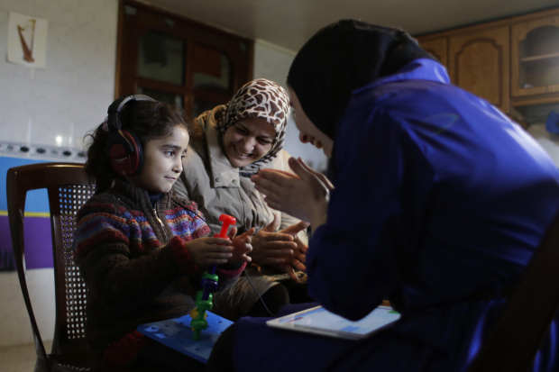 In Pictures: Chicago-based group brings smiles to deaf Syrian children