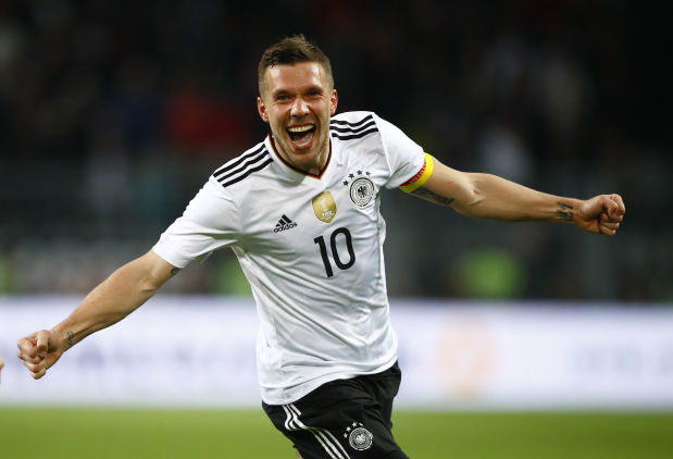 Podolski signs off in style, sinks England with winning goal