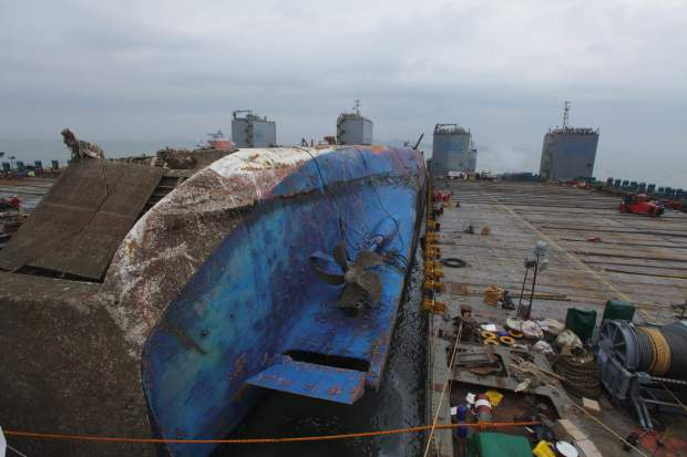 Recovering sunken ferry to heal or harden South Korea's rift