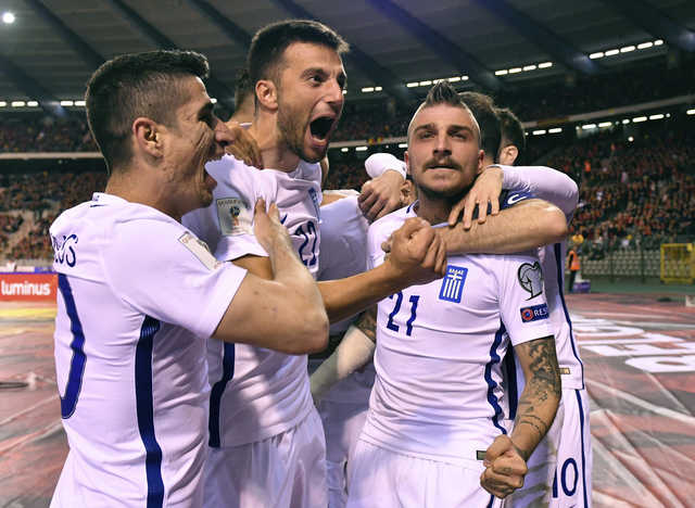 Nine-man Greece holds Belgium to 1-1 in European qualifying