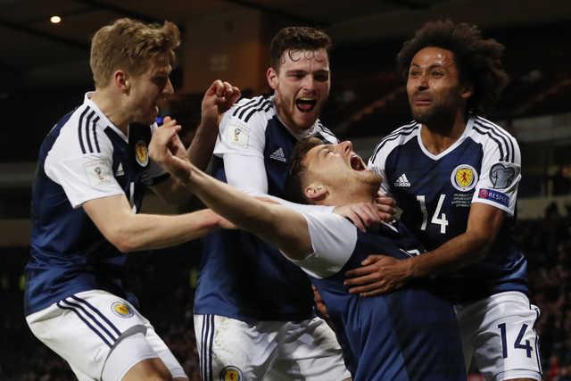 Scotland's hopes still alive after late Martin winner