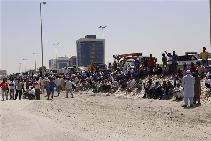 Labourers march over unpaid wages claim