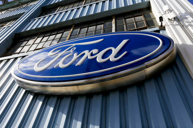 Ford recalls 570,000 vehicles for fire risk, door latch trouble