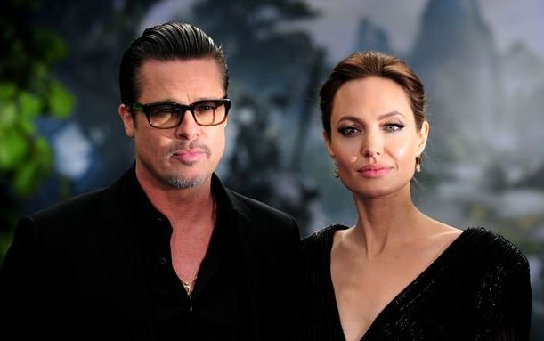 Former studio boss talks about drug testing Angelina, Tom Cruise's religion in biography