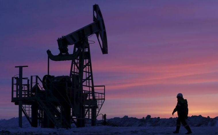 Oil eases from five-week top, rising US production weighs