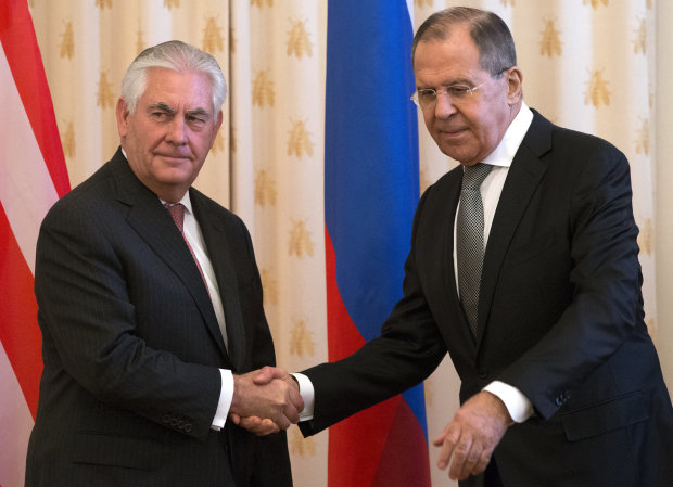 Putin says trust erodes under Trump as Moscow icily receives Tillerson