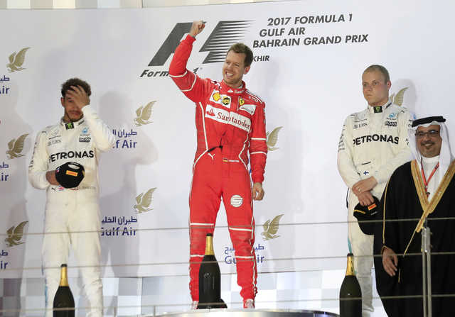 Vettel holds off late Hamilton charge to win Bahrain GP