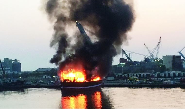 Car plunges into the sea as distracted driver watches boat blaze