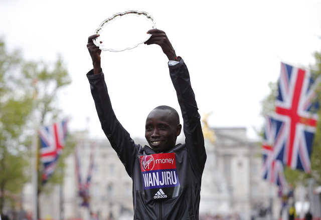 Wanjiru holds off Bekele to win London Marathon