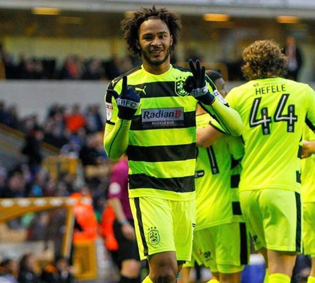 Championship: Huddersfield seal playoff place with win at Wolves