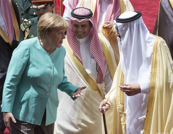 Photos: Saudi King meets German Chancellor
