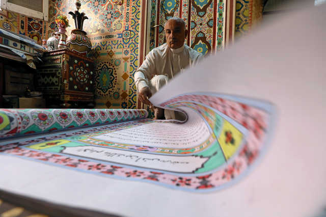 IN PICTURES: Egyptian artist hopes for record with 700-metre Quran