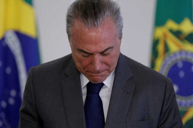 Brazil president taped discussing pay-off for witness in graft probe