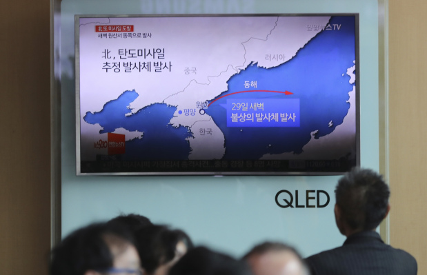 North Korea fires missile into Japan's maritime economic zone in latest provocation