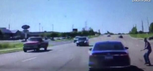 Video: Man jumps into moving car to save driver having seizures