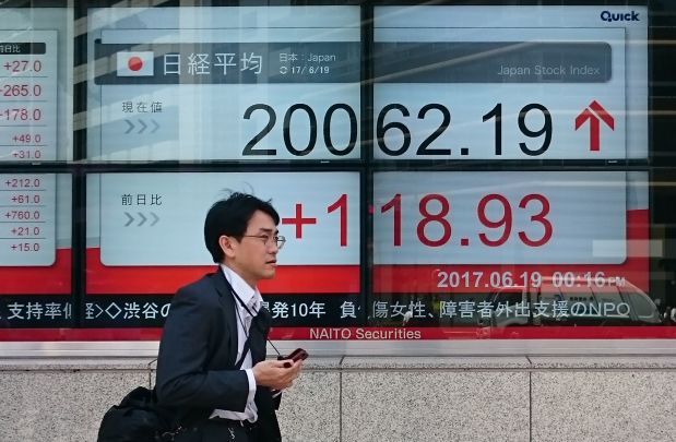IMF says Japan needs to stick with fiscal, monetary stimulus