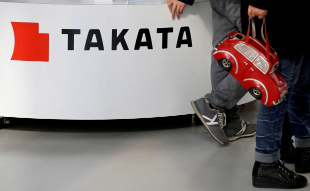 Tokyo stocks close lower, Takata dives on bankruptcy fears