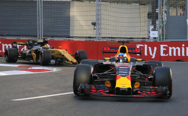 Ricciardo wins amid chaos