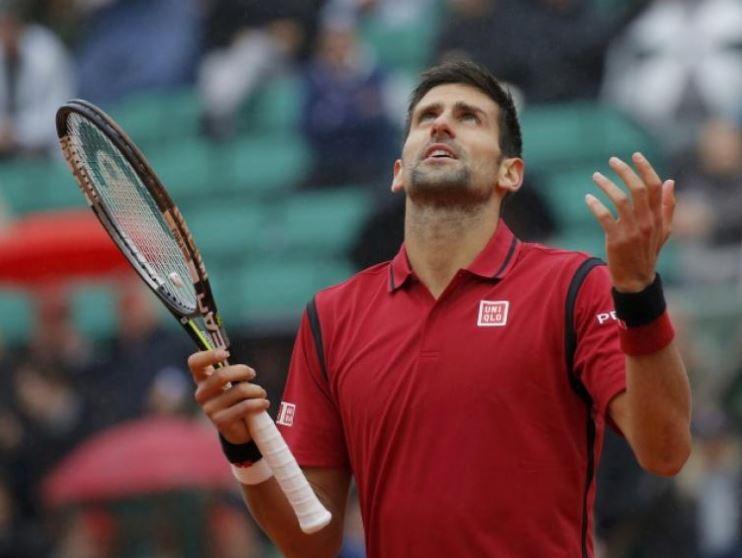 Djokovic frustrated by rain
