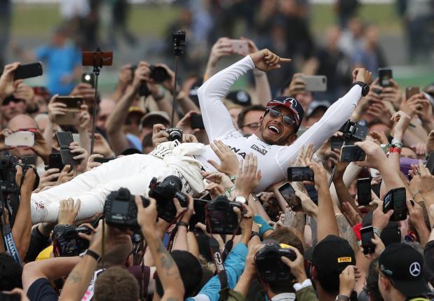 Lewis Hamilton wins British GP to close on Vettel