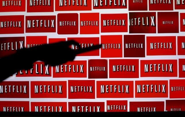 Netflix shares jump as subscriptions top 100 million