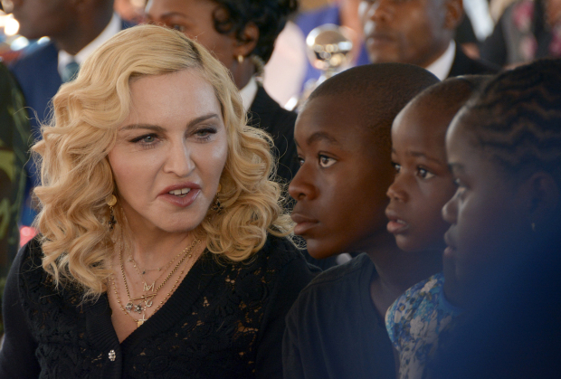 Madonna asks court to block auction of personal items including love letter from Tupac