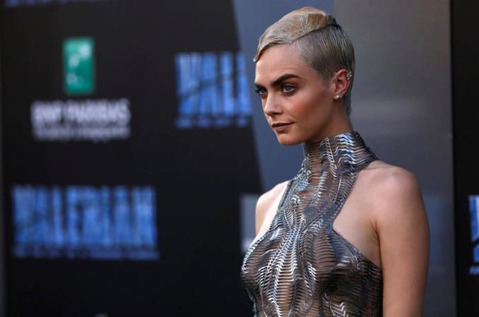 Cara Delevingne: model, actress 'hopeless romantic'