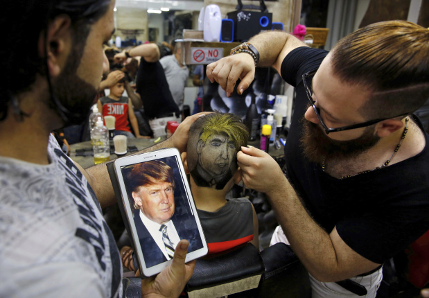 In Pictures: Syrian barber uses clients' heads as canvas to create portraits