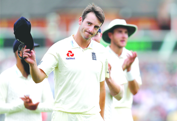 England keep momentum in third Test despite rain