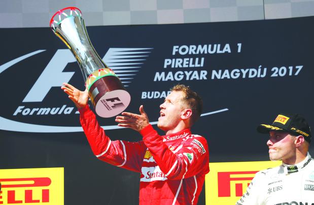 Ferrari's Vettel wins tense Hungarian Grand Prix