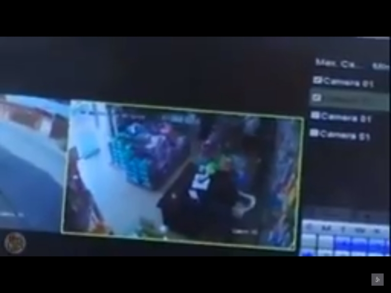 Video: Masked thieves break into pharmacy, threaten staff and steal money