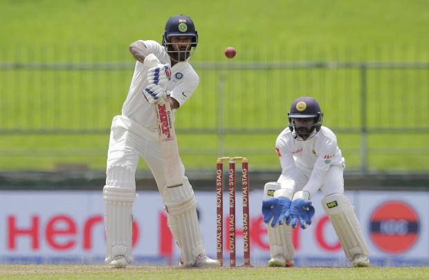 Dhawan hits hundred before Sri Lanka strike back