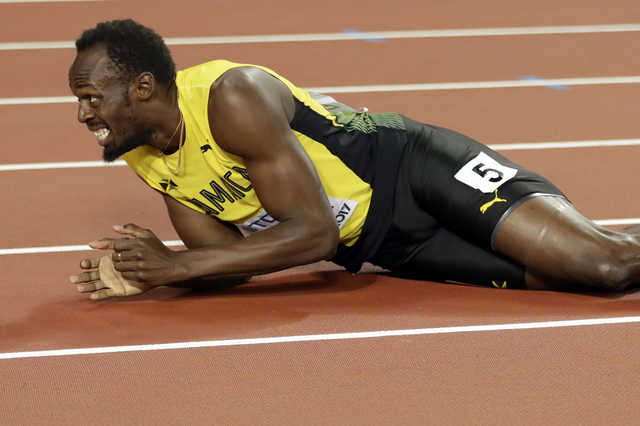 Pictures: Bolt pulls up injured in final race of his career