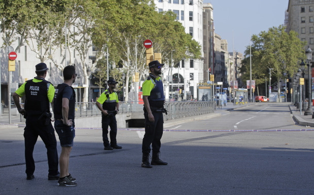 PHOTOS: Two dead as van rams crowd on popular Barcelona street