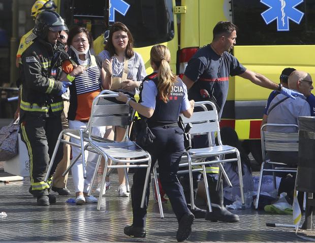 PHOTOS: Two dead as van rams crowd on popular Barcelona street